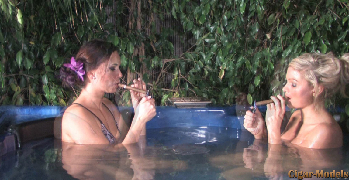 Emma Spellar and Charlee Lynn smoke cigars in the hot tub