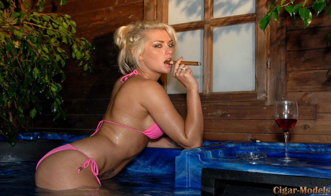 Natasha Marley smokes a big fat cigar in the hot tub
