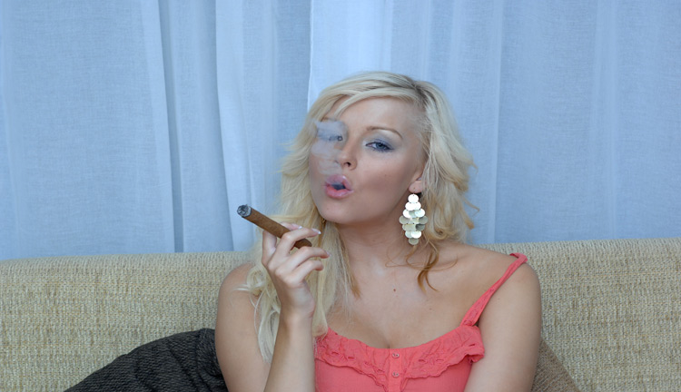 Morgan Lees smokes a big cigar