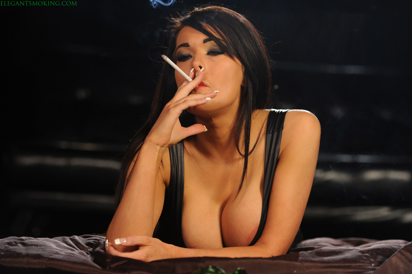 Charley smoking VS120s in a little dress