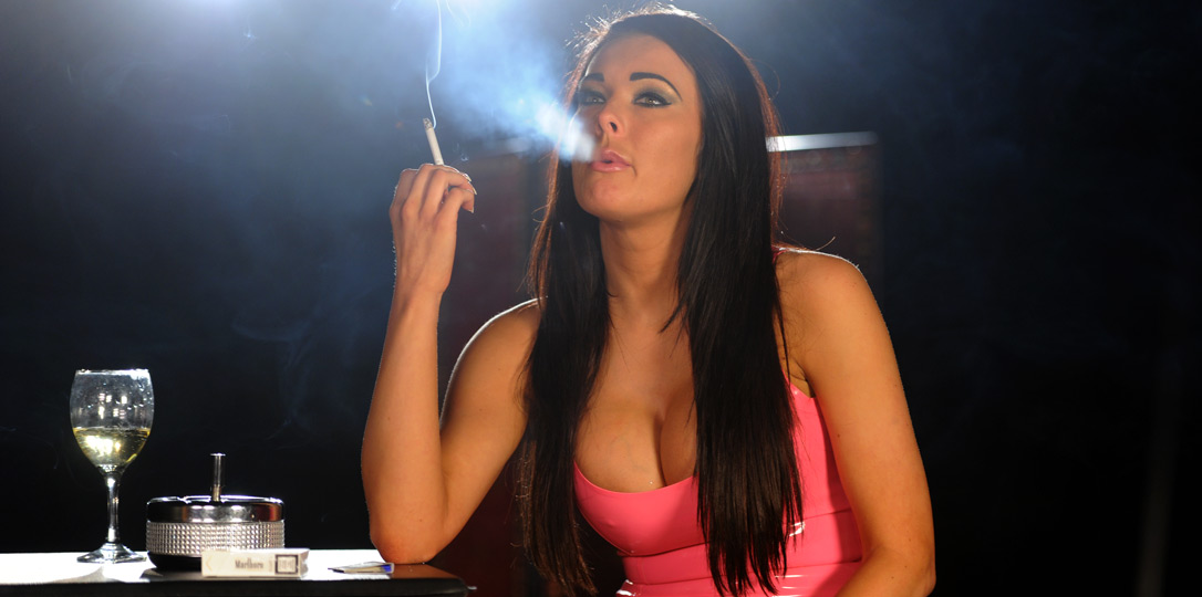 Charley smoking in pink latex dress