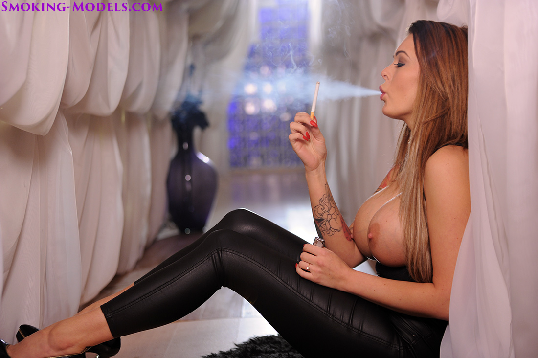 Charley smoking corks 100s in leather leggings topless