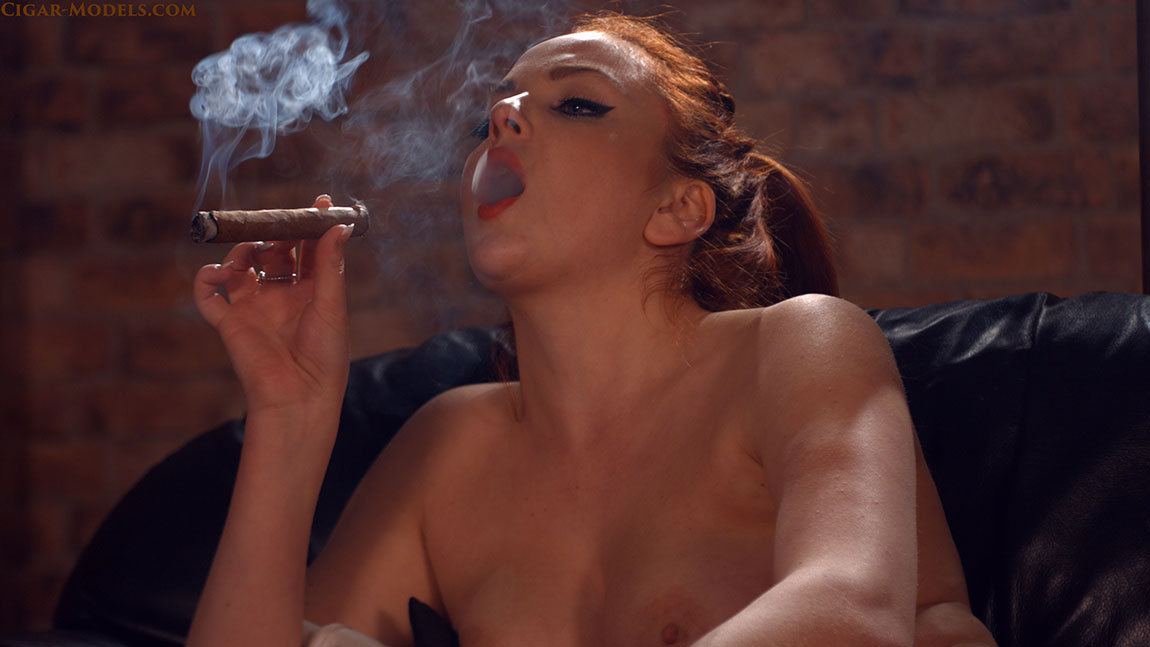Kara Carter smoking a big cigar naked